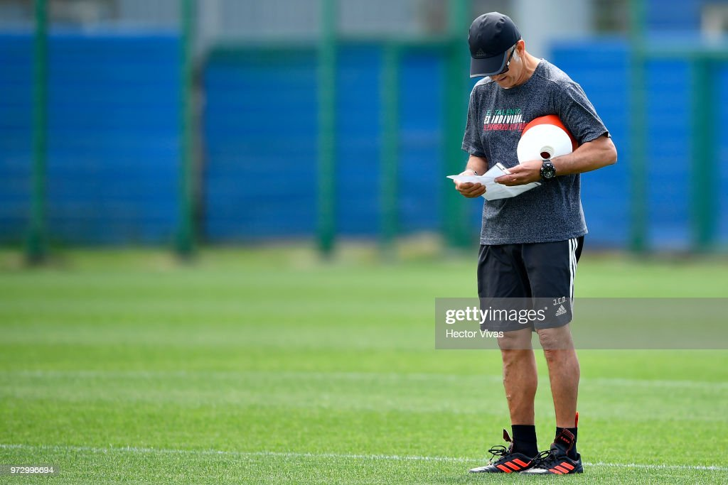 Juan Carlos Osorio, coach of Mexico, reads a paper during a training session at team training base Novogorsk-Dynamo on June 13, 2018 in Moscow, Russia.