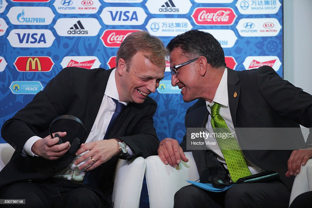 Juan Carlos Osorio, coach of the Mexican national soccer team (R) and Collin Smith, director of FIFA competitions (L) talk during the FIFA Confederations Media Event at CAR on May 11, 2016 in Mexico City, Mexico.