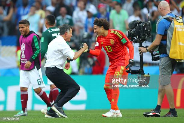 Juan Carlos Osorio head coach / manager of Mexico celebrates with Guillermo Ochoa at the end of the 2018 FIFA World Cup Russia group F match between...