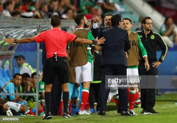 Juan Carlos Osorio head coach of Mexico argues with the assistant referee during the FIFA Confederations Cup Russia 2017 Group A match between Mexico...