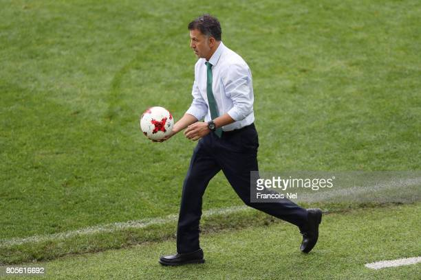 Juan Carlos Osorio head coach of Mexico collects the ball during the FIFA Confederations Cup Russia 2017 PlayOff for Third Place between Portugal and...