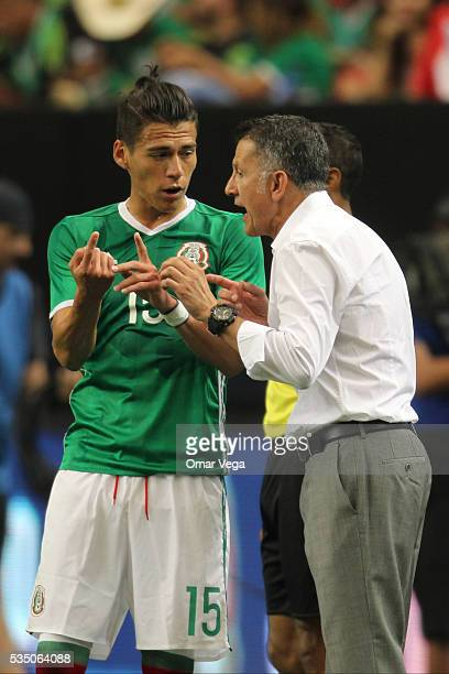 Juan Carlos Osorio head coach of Mexico gives instructions to his player Hector Moreno during the international friendly match between Mexico and...