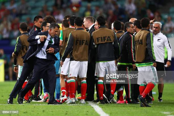 Juan Carlos Osorio head coach of Mexico is restrained during the FIFA Confederations Cup Russia 2017 Group A match between Mexico and New Zealand at...
