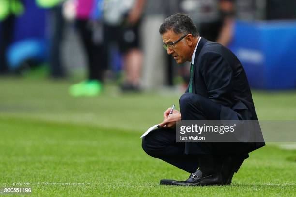 Juan Carlos Osorio head coach of Mexico makes a note during the FIFA Confederations Cup Russia 2017 Group A match between Mexico and Russia at Kazan...