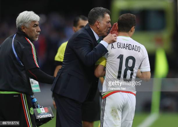 Juan Carlos Osorio head coach of Mexico speaks to Andres Guardado of Mexico during the FIFA Confederations Cup Russia 2017 Group A match between...