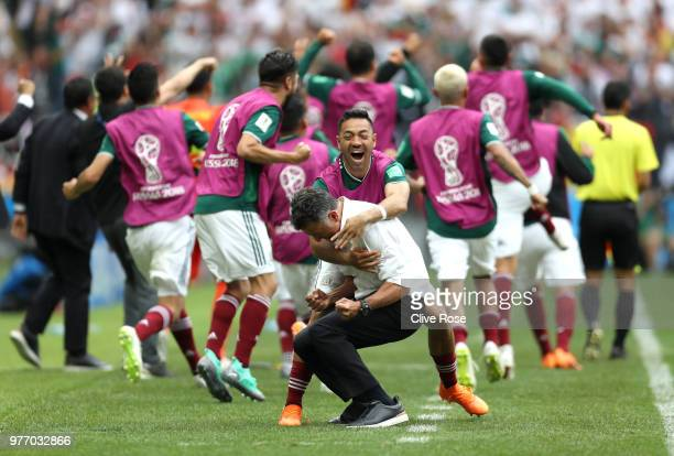Juan Carlos Osorio Manager of Mexico celebrates with Marco Fabian of Mexico after their sides first goal during the 2018 FIFA World Cup Russia group...