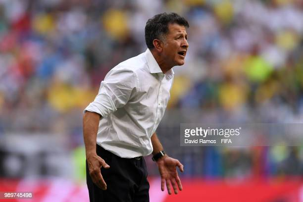 Juan Carlos Osorio Manager of Mexico gives his team instructions during the 2018 FIFA World Cup Russia Round of 16 match between Brazil and Mexico at...