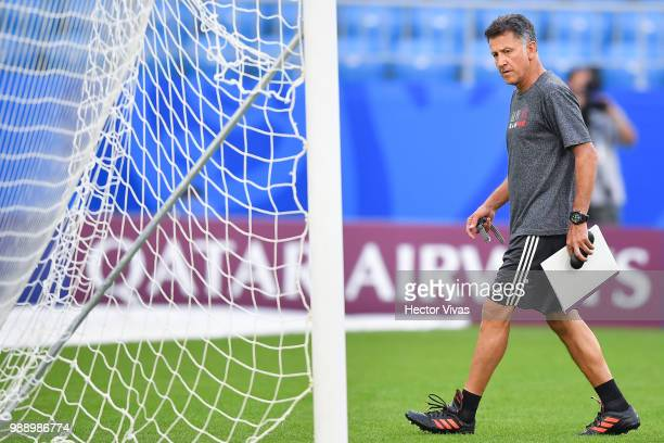 Juan Carlos Osorio of Mexico looks on during a training at Samara Arena ahead of the Round of Sixteen match against Brazil on July 1 2018 in Samara...