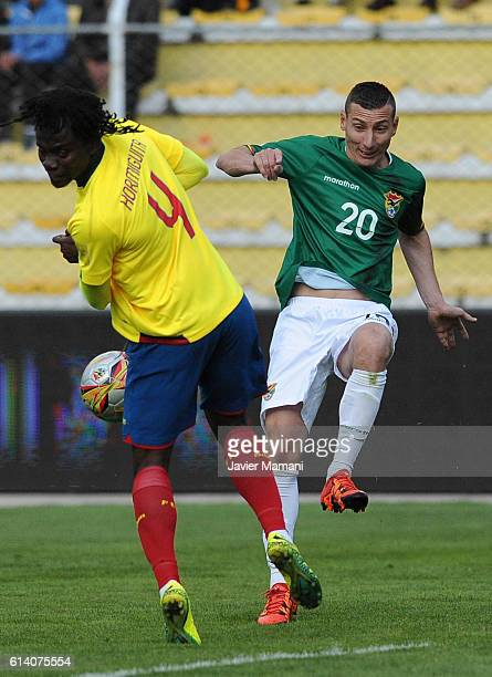Juan Carlos Paredes of Ecuador and Pablo Escobar of Bolivia fight for the ball during a match between Bolivia and Ecuador as part of FIFA 2018 World...