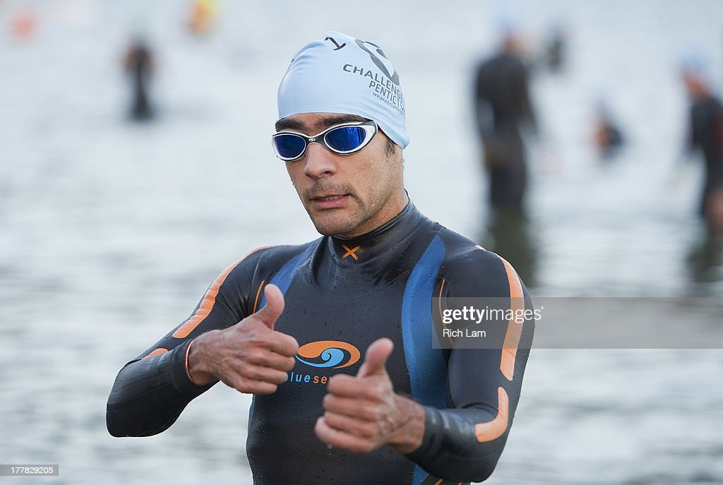 Juan Carlos Ramirez poses for a picture prior to the start of the Challenge Penticton Triathlon on August 25, 2013 in Penticton, British Columbia, Canada.