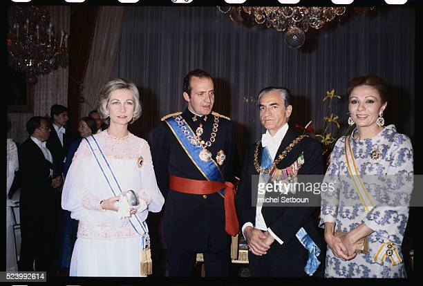 Juan Carlos the King of Spain visits the Shah of Iran in Tehran Iran From left to rigth Sofia Queen of Spain Juan Carlos King of Spain Shah Mohammad...