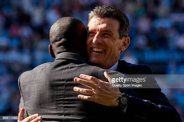 Juan Carlos Unzue the manager of Celta de Vigo hugs Clarence Seedorf the manager of Deportivo de La Coruna prior to the La Liga match between Celta...