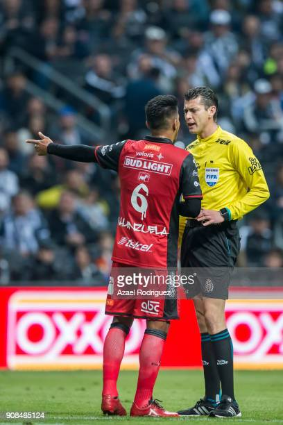 Juan Carlos Valenzuela of Tijuana argues with referee Erick Miranda during the third round match between Monterrey and Tijuana as part of Torneo...