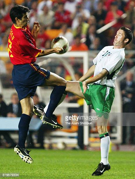 Juan Carlos Valeron of Spain and Robbie Keane of Ireland compete for the ball during the FIFA World Cup Korea/Japan round of 16 match between Spain...