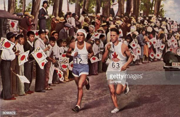 Juan Carlos Zabala of Argentina overtakes a Canadian runner to win the marathon event in the 1932 Olympic Games held in the crowded streets of Los...