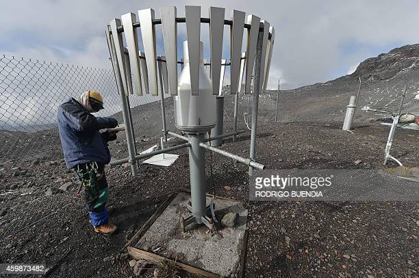 Juan Carvajal scientist of the Ecuador Glaciers Program works at a meteorolgical station on the slopes of the snowcapped Antisana volcano in the...