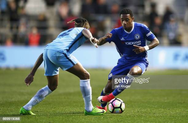 Juan Castillo of Chelsea attempts to take the ball past Demeaco Duhaney of Manchester City during the FA Youth Cup Final First Leg match between...