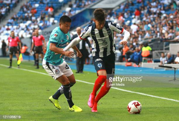 Juan Castro of San Luis fights for the ball with Daniel Parra of Monterrey during the 9th round match between Monterrey and Atletico San Luis as part...
