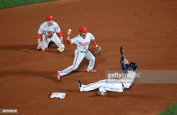 Juan Castro of the Philadelphia Phillies turns a double play against Jason Heyward of the Atlanta Braves at Turner Field on April 21 2010 in Atlanta...