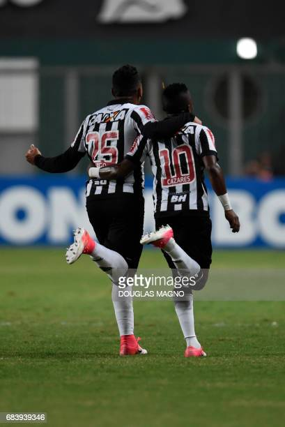 TOPSHOT Juan Cazares of Brazil's Atletico Mineiro celebrates with a teammate after scoring a goal against Argentina's Godoy Cruz during their 2017...