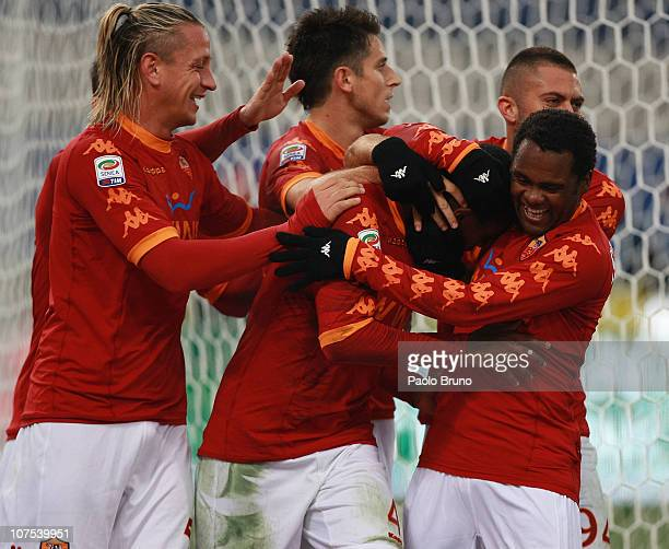 Juan celebrates with his teammates of AS Roma after scoring the opening goal during the Serie A match between AS Roma and AS Bari at Stadio Olimpico...