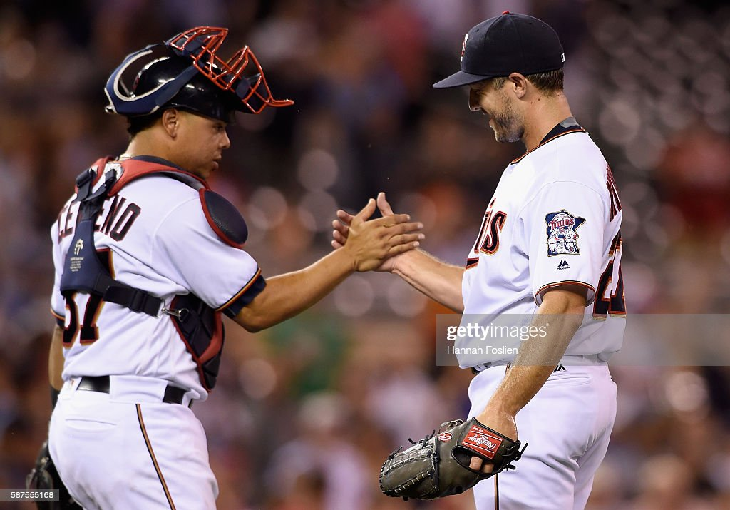 Juan Centeno #37 and Brandon Kintzler #27 of the Minnesota Twins celebrate winning the game against the Houston Astros on August 8, 2016 at Target Field in Minneapolis, Minnesota. The Twins defeated the Astros 3-1.