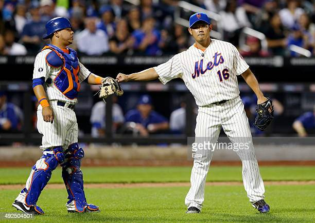 Juan Centeno and Daisuke Matsuzaka of the New York Mets celebrate an out in the eighth inning against the Los Angeles Dodgers on May 20 2014 at Citi...