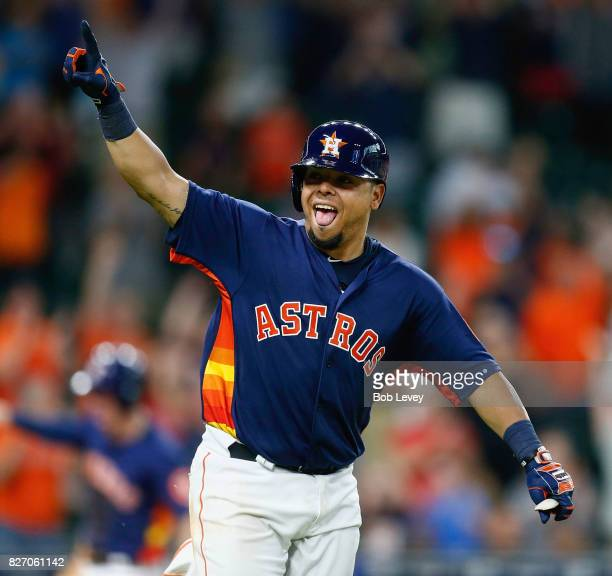 Juan Centeno of the Houston Astros celebrates after hitting a walkoff sibgle in the ninth inning against the Toronto Blue Jays at Minute Maid Park on...
