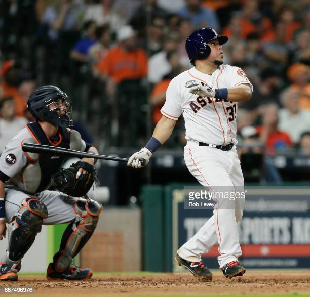 Juan Centeno of the Houston Astros hits a home run in the fourth inning against the Detroit Tigers at Minute Maid Park on May 23 2017 in Houston Texas