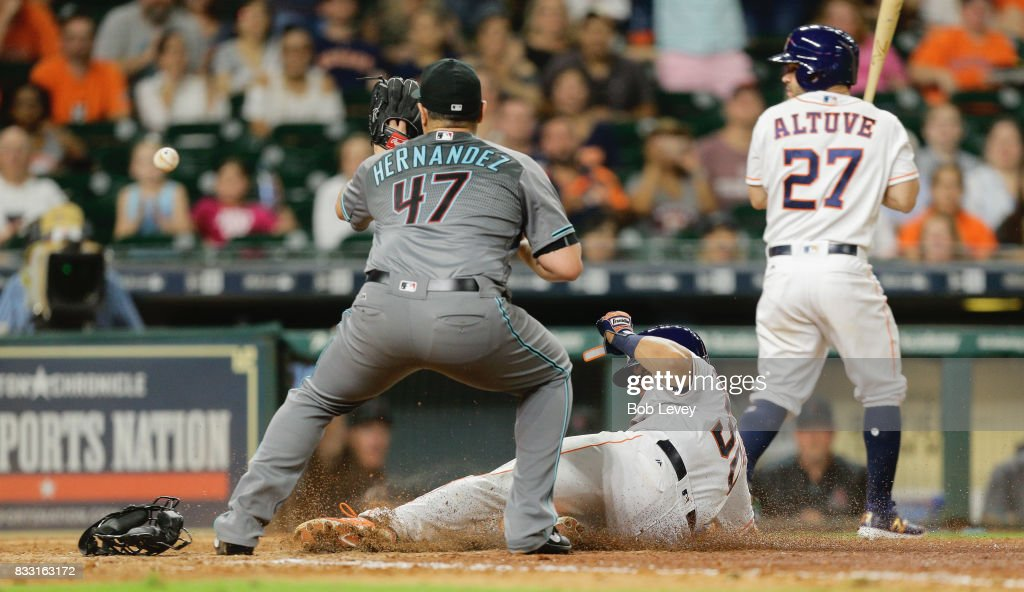 Juan Centeno #30 of the Houston Astros scores on a wild pitch by David Hernandez #47 of the Arizona Diamondbacks in the eighth inning at Minute Maid Park on August 16, 2017 in Houston, Texas.