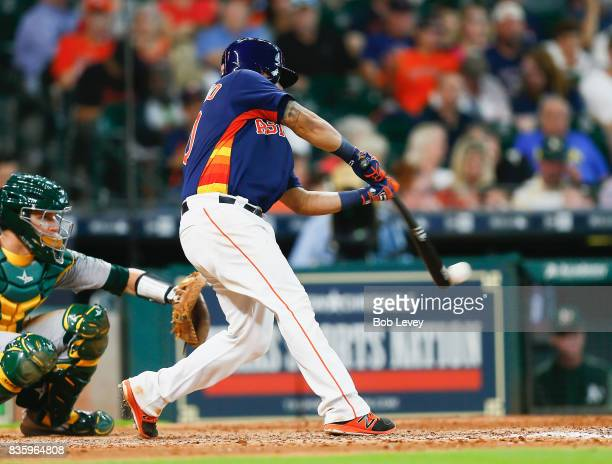 Juan Centeno of the Houston Astros singles in the seventh inning against the Oakland Athletics at Minute Maid Park on August 20 2017 in Houston Texas