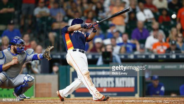 Juan Centeno of the Houston Astros singles in the winning run in the ninth inning against the Toronto Blue Jays at Minute Maid Park on August 6 2017...