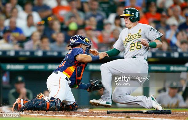 Juan Centeno of the Houston Astros tags out Ryon Healy of the Oakland Athletics in the sixth inning at Minute Maid Park on August 20 2017 in Houston...