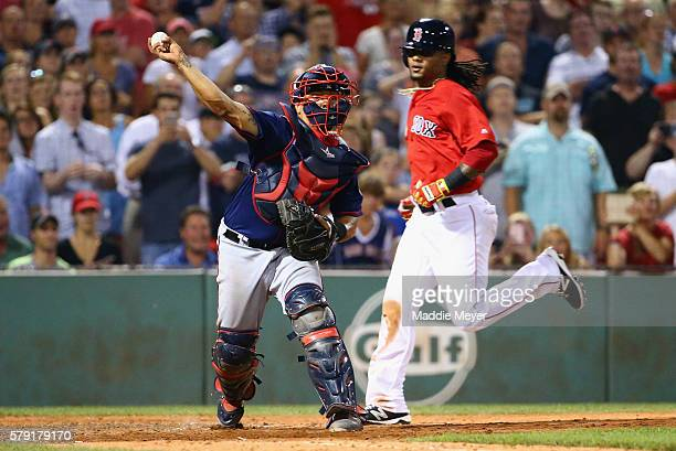 Juan Centeno of the Minnesota Twins throws to first after tagging out Michael Martinez of the Boston Red Sox at home during the ninth inning at...