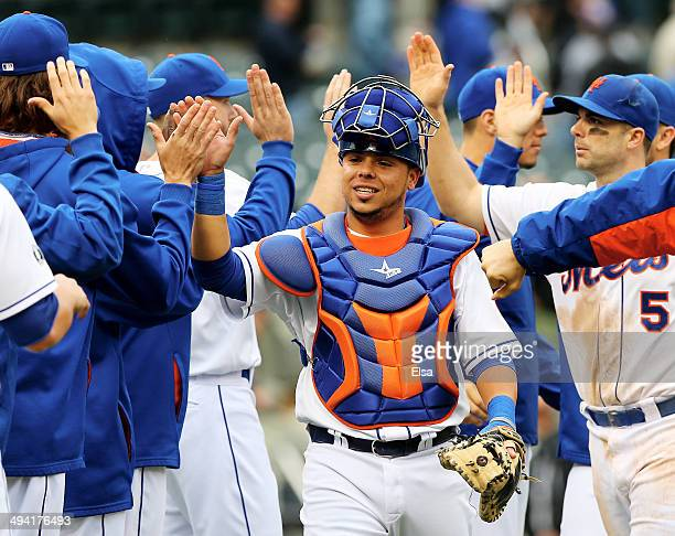 Juan Centeno of the New York Mets celebrates the 50 win over the Pittsburgh Pirates with teammates after the game on May 28 2014 at Citi Field in the...