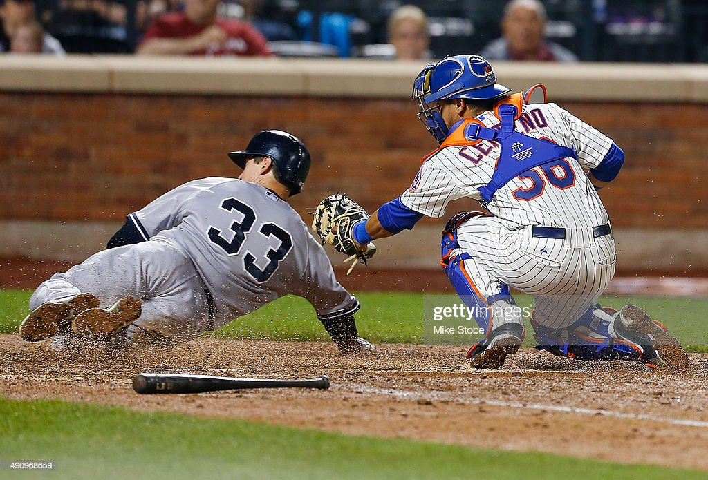 Juan Centeno #36 of the New York Mets tags out Kelly Johnson #33 of the New York Yankees at home plate on a Derek Jeter (not pictured) ground ball to shortstop in the eighth inning on May 15, 2014 at Citi Field in the Flushing neighborhood of the Queens borough of New York City.