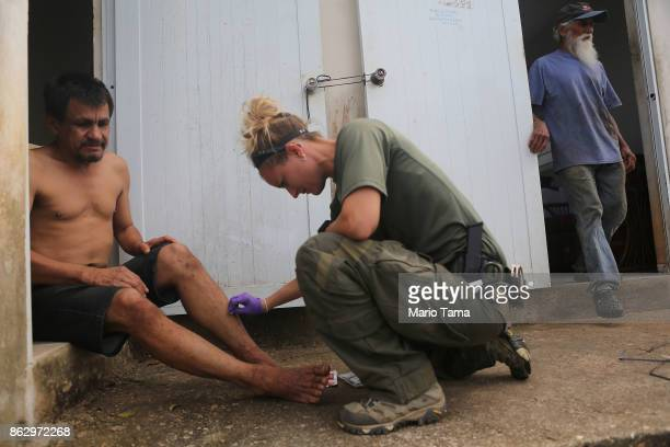 Juan Cordero who has no electricity or running water receives treatment for ant bites from special agent and medic Ashley Wilson from the Special...