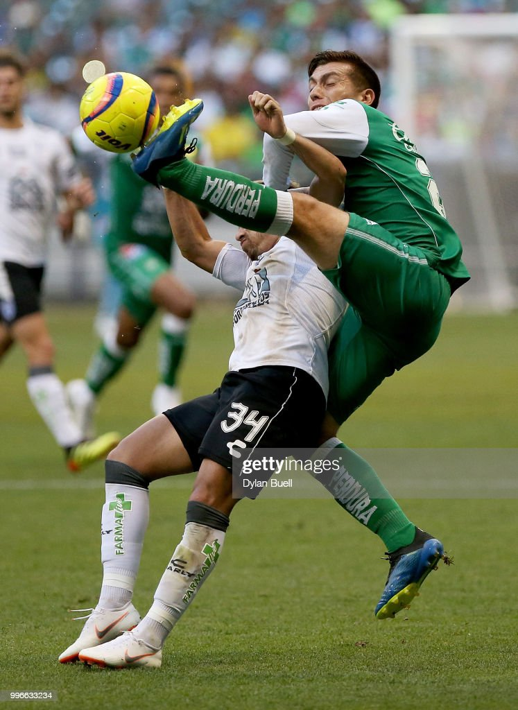 Juan Cornejo #23 of Club Leon attempts a kick around Sebastian Palacios #34 of CF Pachuca in the first half at Miller Park on July 11, 2018 in Milwaukee, Wisconsin.