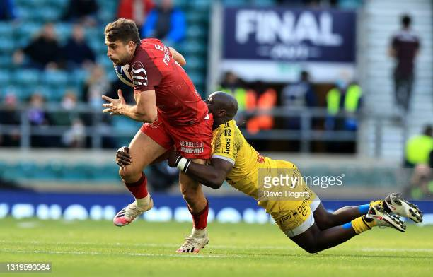 Juan Cruz Mallia of Toulouse is tackled by Raymond Rhule during the Heineken Champions Cup Final match between La Rochelle and Toulouse at Twickenham...