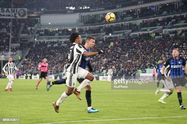 Juan Cuadrado and Ivan Perisic compete for the ball during the Serie A football match between Juventus FC and FC Internazionale at Allianz Stadium on...