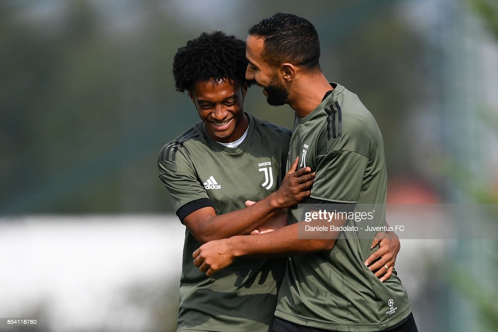 Juan Cuadrado and Medhi Benatia during a Juventus Training Session at Juventus Center Vinovo on September 26, 2017 in Vinovo, Italy.