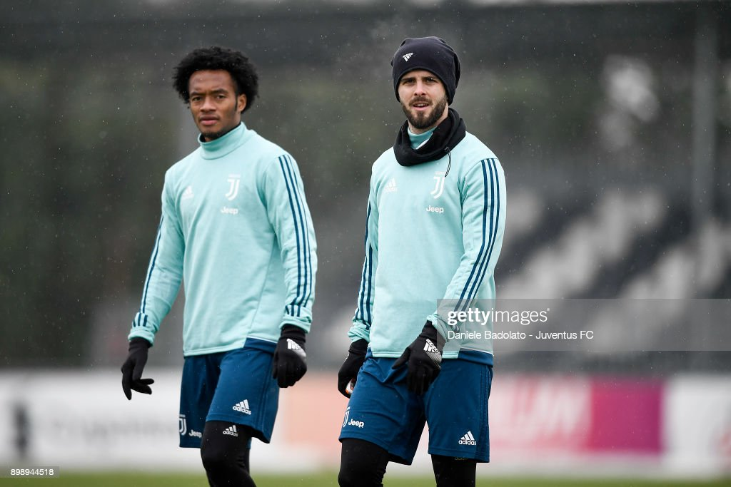 Juan Cuadrado and Miralem Pjanic during a Juventus Training Session at Juventus Center Vinovo on December 27, 2017 in Vinovo, Italy.