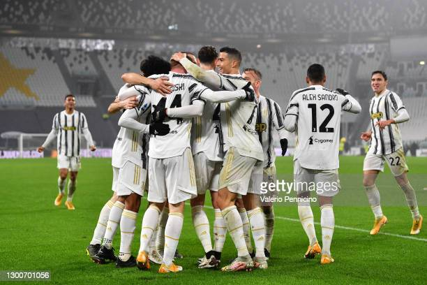 Juan Cuadrado, Dejan Kulusevski, Alex Sandro, and Cristiano Ronaldo of Juventus celebrate with their teammates following their team's second goal, an...