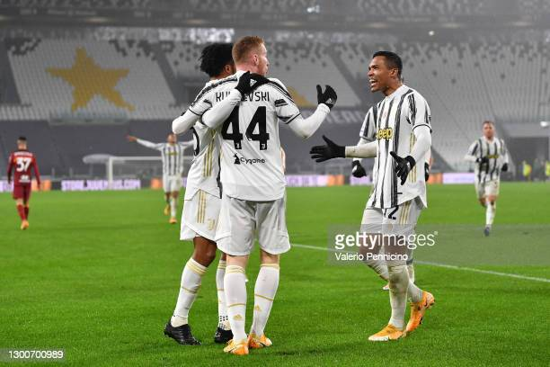 Juan Cuadrado, Dejan Kulusevski, and Alex Sandro of Juventus celebrate following their team's second goal, an own goal by Ibanez of A.S Roma during...