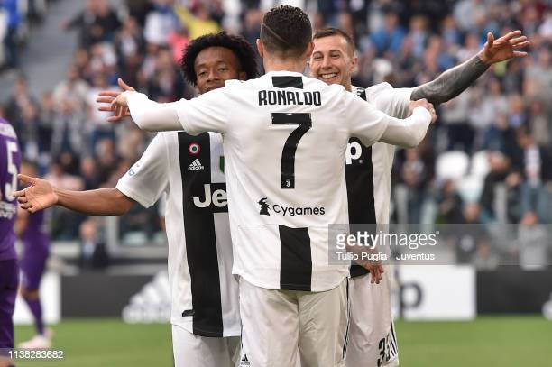 Juan Cuadrado, Federico Bernardeschi and Cristiano Ronaldo of Juventus celebrate after the own goal scored by German Pezzella of ACF Fiorentina...