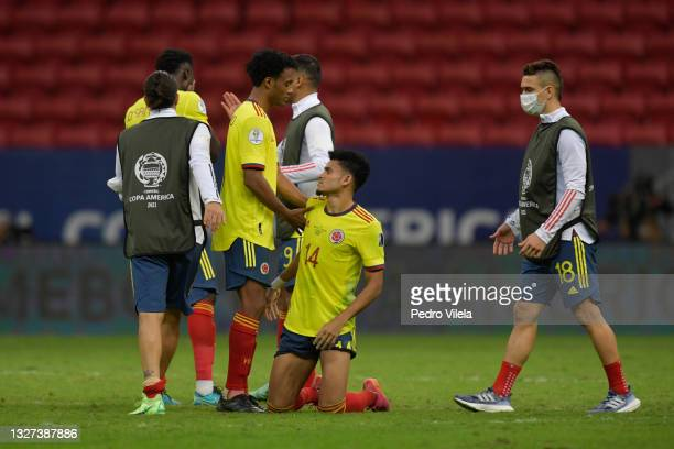 Juan Cuadrado, Luis Diaz and Rafael Santos Borre of Colombia react after losing a penalty shootout after a semi-final match of Copa America Brazil...