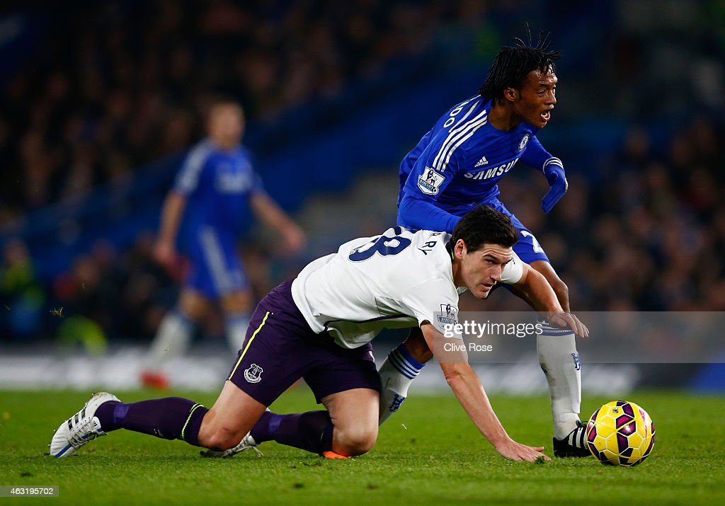 Juan Cuadrado of Chelsea clashes with Gareth Barry of Everton during the Barclays Premier League match between Chelsea and Everton at Stamford Bridge on February 11, 2015 in London, England.