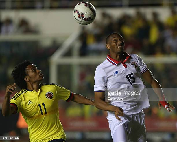 Juan Cuadrado of Colombia and Junior Diaz of Costa Rica go for a header during a friendly match between Colombia and Costa Rica at Diego Armando...
