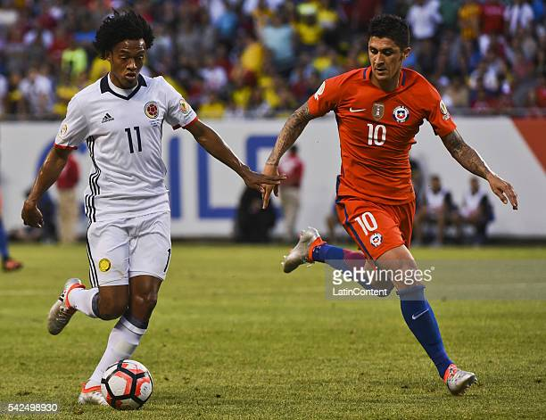 Juan Cuadrado of Colombia and Pablo Hernandez of Chile fight for the ball during a Semifinal match between Colombia and Chile at Soldier Field as...