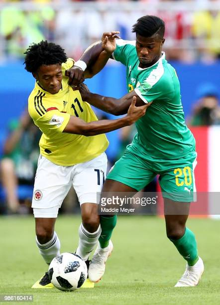 Juan Cuadrado of Colombia battles for possession with Keita Balde of Senegal during the 2018 FIFA World Cup Russia group H match between Senegal and...
